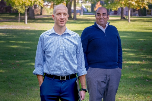 Peter Enns, College of Arts and Sciences, stands on campus with Presidential Postdoctoral Fellow Vivek Ashok.