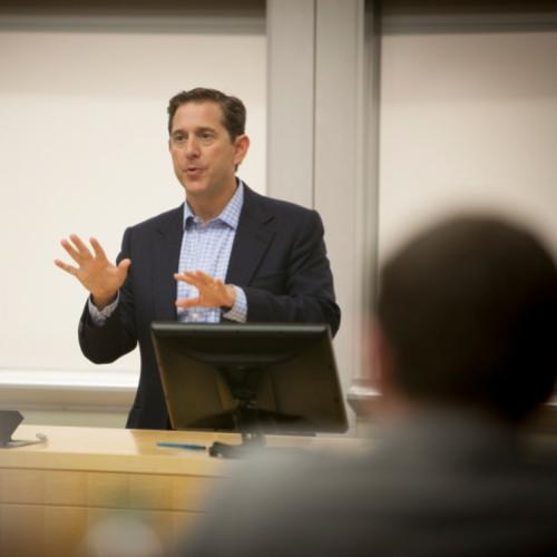 Richard Baker '88, Governor and CEO of Hudson's Bay Company, speaks to Hotel Administration (SHA) students in the Baker Program in Real Estate (PRE).