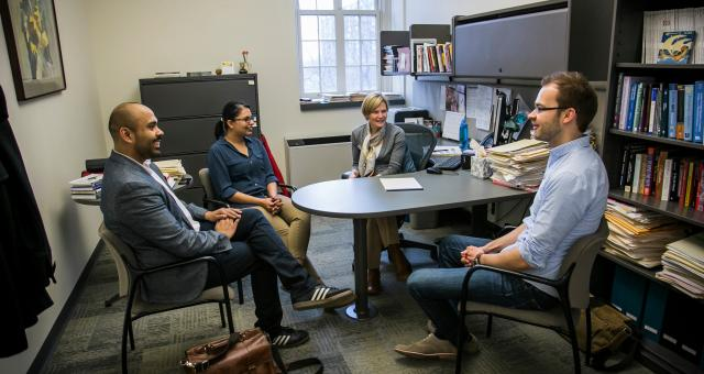 Besharov meets with her graduates students—Luis Martinez from Architecture, Art, and Planning; Rohini Jalan, Industrial and Labor Relations; and Bjoern Mitzinneck, Johnson Graduate School of Management.